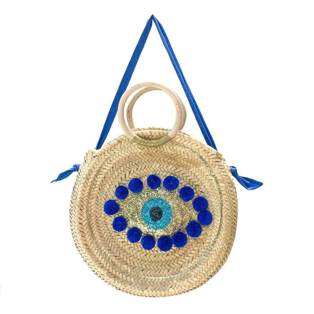 A Petit Nomade bag featuring an Evil Eye design.
