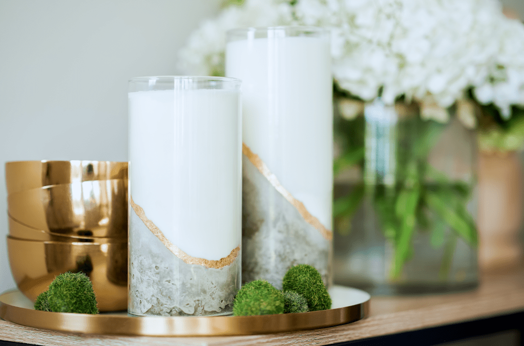 Candles featuring a concrete base and golden accents.