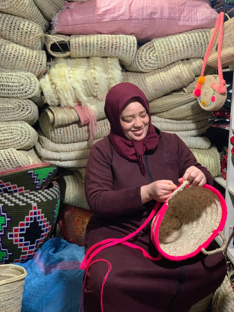 An artisan in  Marrakech, Morocco crafting a basket for Petit Nomade.