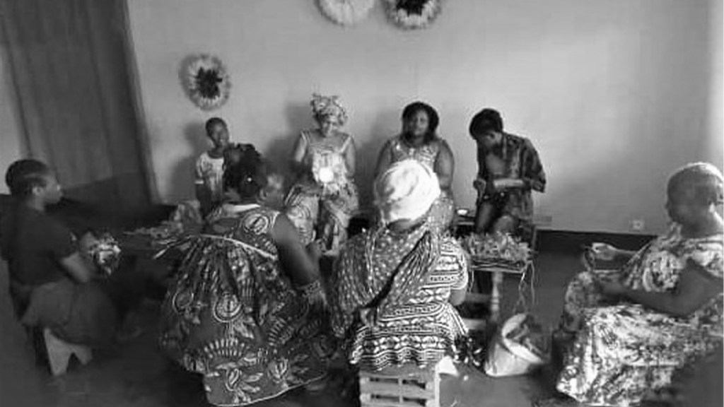 African artisans creating baskets, which will be sold at the Luangisa African Gallery.