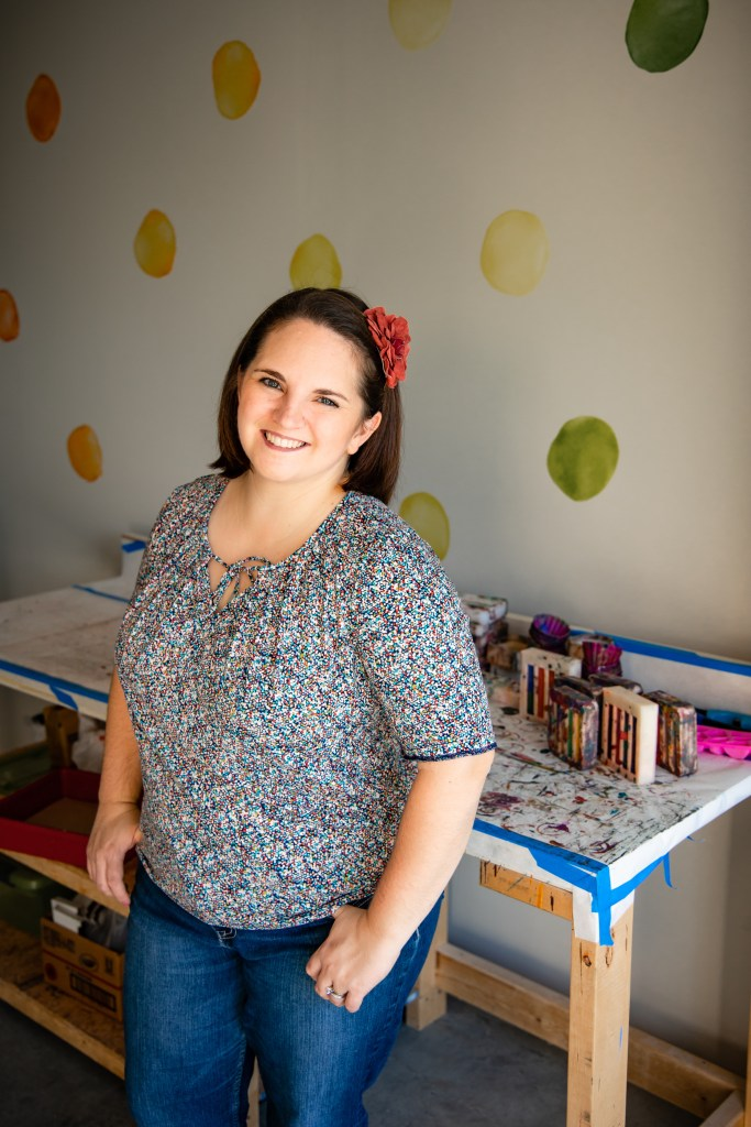 Photograph of Art 2 the Extreme founder Nicole Lewis. Photo taken in her design studio.