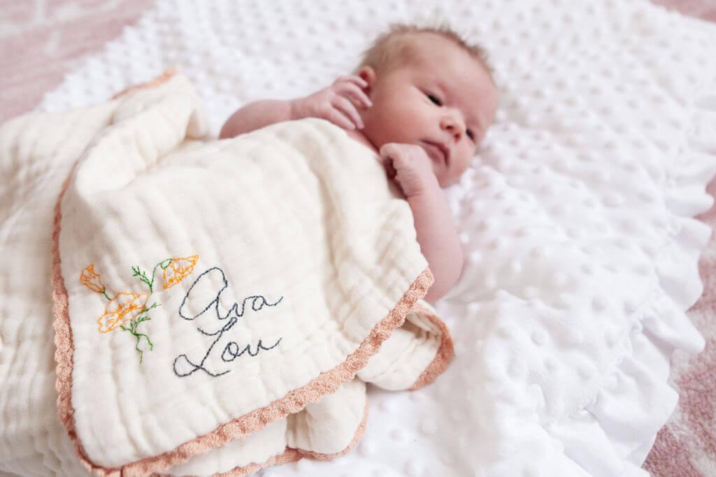 Hand embroidery on a baby blanket by Reina Nishida-Lee founder of Ottotto. Photo courtesy of Reina Nishida-Lee.